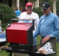 Volunteers grilling for a fundraiser